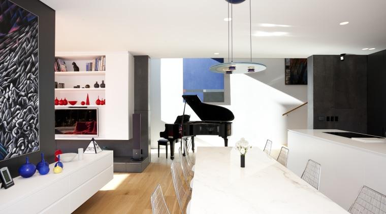 The monochromatic look of the exterior of this floor, flooring, home, interior design, interior designer, living room, product design, room, white