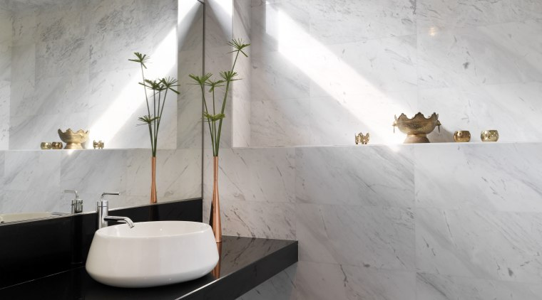 This powder room by Kun Lim Architect follows architecture, bathroom, ceiling, daylighting, floor, flooring, house, interior design, room, tile, wall, gray