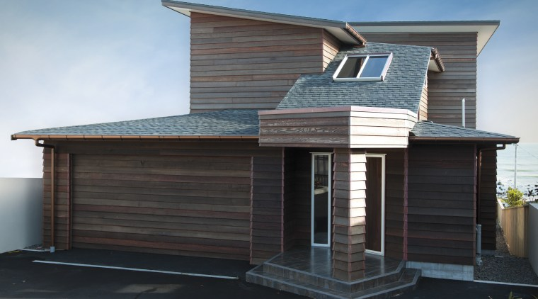 Front view of houses spouting system. building, elevation, facade, home, house, property, real estate, roof, siding, black