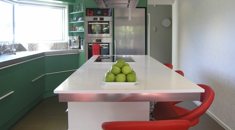 Table and red chairs in green kitchen. countertop, interior design, kitchen, real estate, room, table, gray