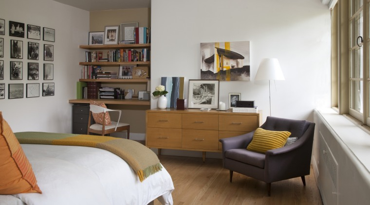 Light-filled bedroom in 1940s house remodeled with bookcase, floor, furniture, home, interior design, living room, loft, room, shelf, shelving, table, gray, brown