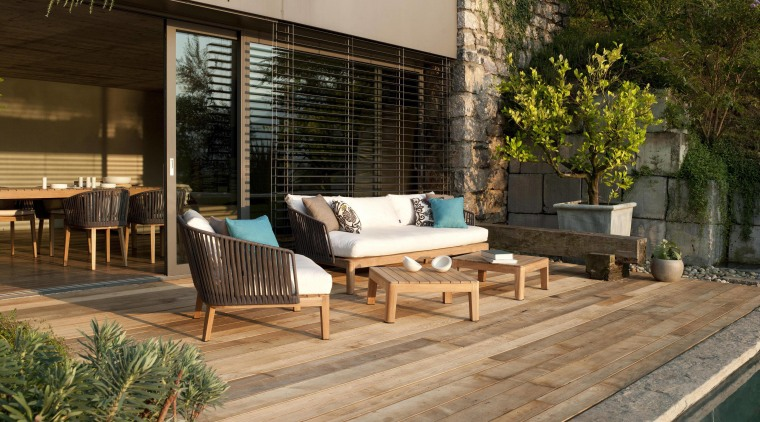 Outdoor mood chair club. architecture, backyard, deck, floor, furniture, house, outdoor furniture, outdoor structure, patio, real estate, sunlounger, table, wood, brown, orange