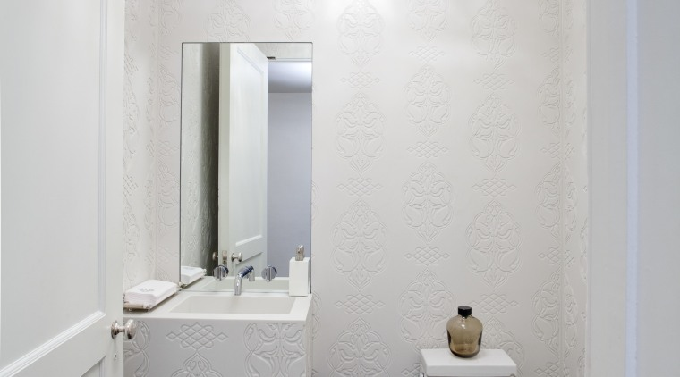 New powder room features computer-etched wall panels with architecture, bathroom, ceiling, daylighting, floor, home, house, interior design, plumbing fixture, real estate, room, sink, white, gray