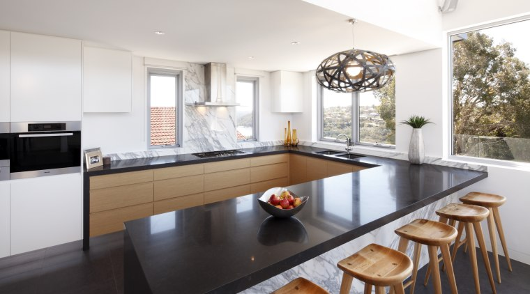 Seen here is a kitchen designed by Wonderful architecture, countertop, cuisine classique, interior design, kitchen, real estate, table, white
