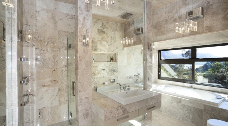 Natural stone and mirrors abound in this family architecture, bathroom, estate, home, interior design, property, real estate, room, gray