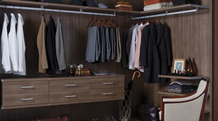 Seen here is a storage system/closet designed and closet, furniture, room, wardrobe, black, gray