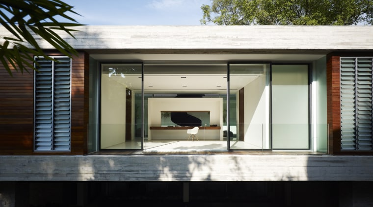 This low-lying, high-end house is by Ong Singapore architecture, facade, home, house, real estate, siding, window, black