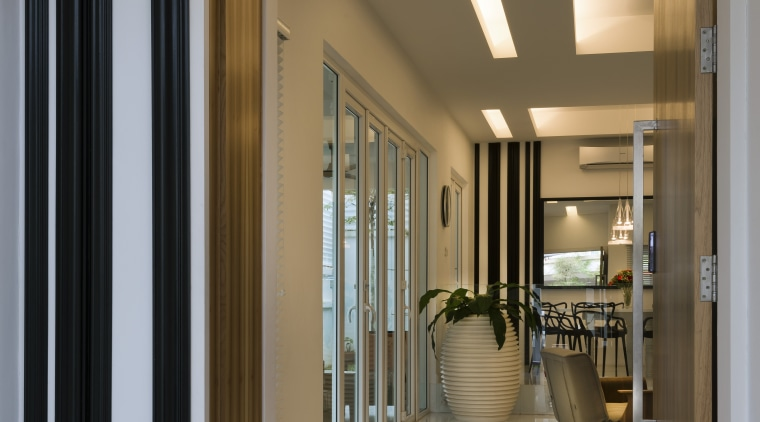 Dark-stained timber slats on the white walls add door, home, interior design, window, brown, gray
