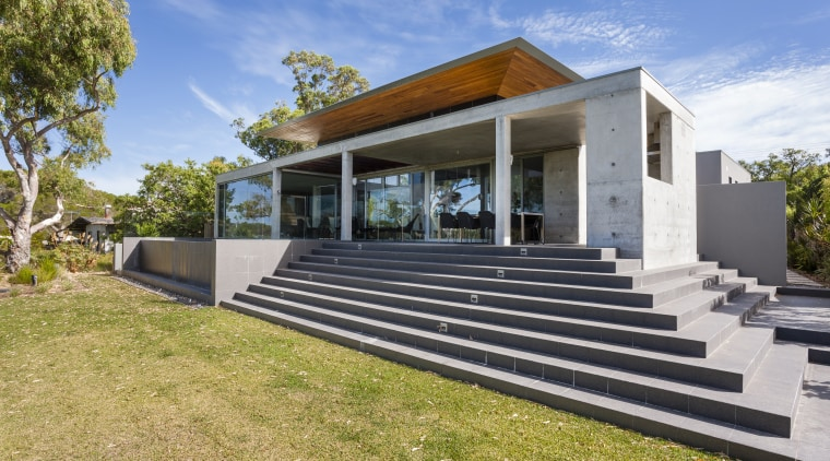 Off-form concrete walls are a feature of this architecture, cottage, elevation, estate, facade, home, house, property, real estate