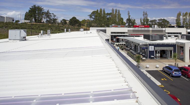 The Silverdale Centre roof was installed by Kiwi real estate, roof, structure, white
