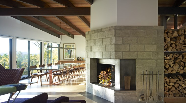 The original ceramic tile fireplace surround in this fireplace, hearth, interior design, living room, wood burning stove, brown