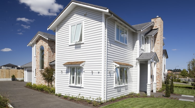 James Hardie Building Products used on House Karaka building, cottage, elevation, estate, facade, farmhouse, home, house, neighbourhood, property, real estate, residential area, siding, sky, suburb, white