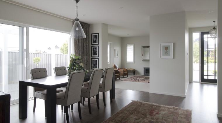 Landmark Homes show home at Karaka Lakes dining room, floor, flooring, house, interior design, living room, property, real estate, room, table, window, gray, white