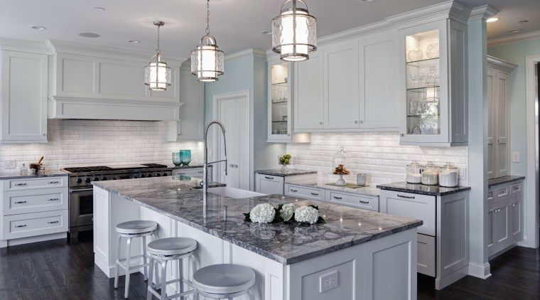 Symmetry is a key feature of this remodeled cabinetry, countertop, cuisine classique, floor, flooring, home, interior design, kitchen, room, gray