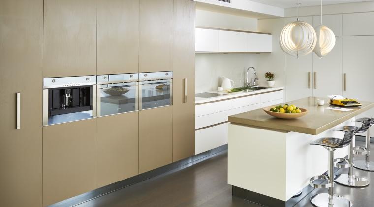 Designer Carolyn Cavanough of Desire Beauty specified a cabinetry, countertop, cuisine classique, home appliance, interior design, kitchen, product design, gray, white