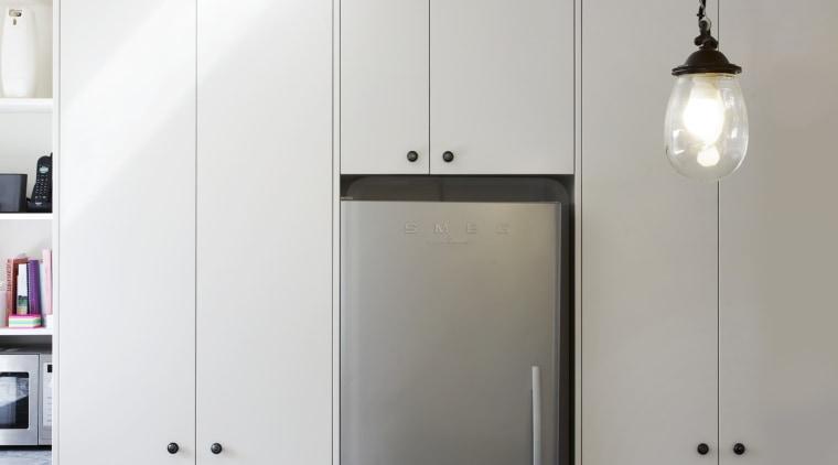The owners chose a Smeg SUK92MX8 90cm range architecture, ceiling, interior design, light fixture, product design, gray, white