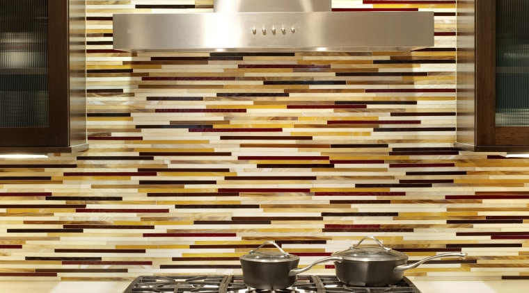 A sense of balance was important in the countertop, flooring, interior design, kitchen, wall, brown, yellow