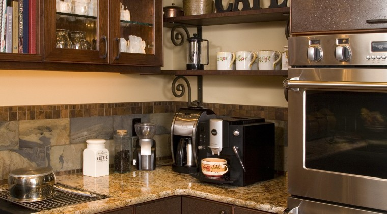 The scullery in this traditional wood kitchen includes cabinetry, countertop, cuisine classique, home appliance, interior design, kitchen, kitchen organizer, room, brown
