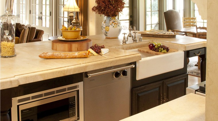 Dark wood beams in this Provencal-style kitchen relieve cabinetry, countertop, cuisine classique, floor, flooring, furniture, interior design, kitchen, room, orange, brown