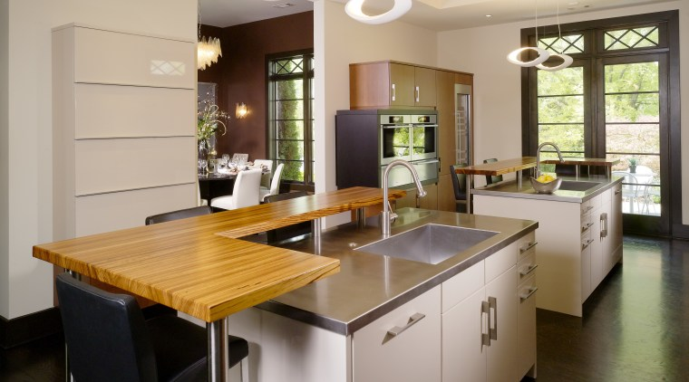 Soft, ovoid lighting provides a contrast to the cabinetry, countertop, interior design, kitchen, real estate, room, gray