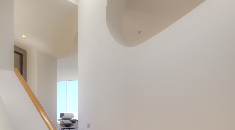 The distinctive shape of a cutout in the architecture, ceiling, daylighting, handrail, home, house, interior design, light, product design, property, stairs, wall, gray