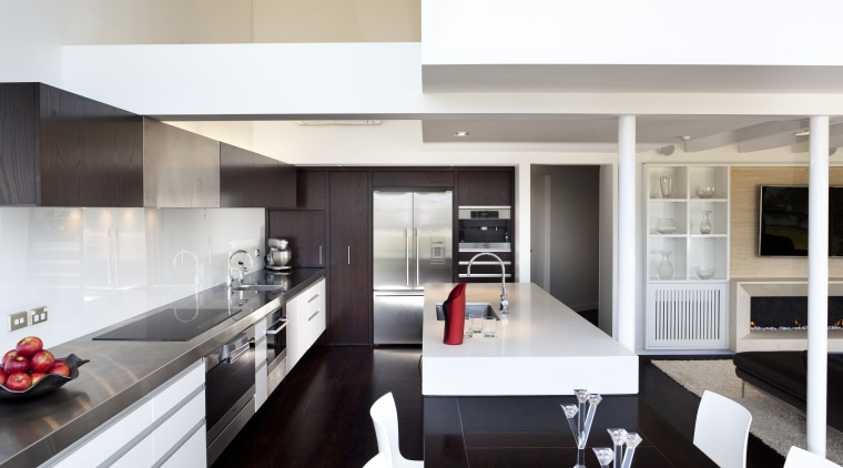 A hard-wearing stainless steel bench is designated as countertop, cuisine classique, interior design, kitchen, white, gray, black