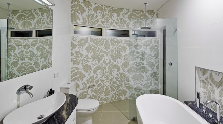 Every room receives the same close attention to bathroom, floor, flooring, home, interior design, property, real estate, room, tile, wall, window, gray
