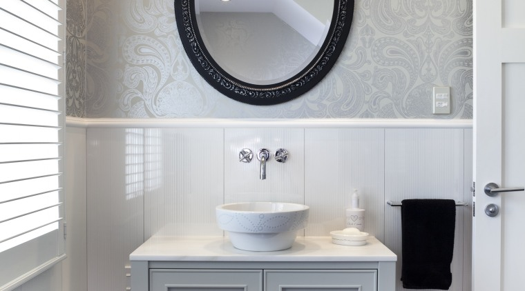 The vanity in the guest bathroom is painted bathroom, bathroom accessory, bathroom cabinet, bathroom sink, floor, flooring, home, interior design, plumbing fixture, product design, room, sink, tap, gray