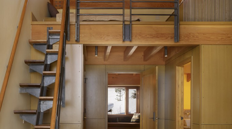 This guest suite builds on the exposed structural beam, ceiling, interior design, stairs, wood, brown