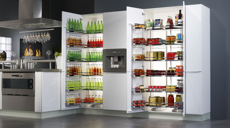 All the items stored in a Kessebohmer Tandem display case, product, refrigerator, shelf, shelving, gray, white, black