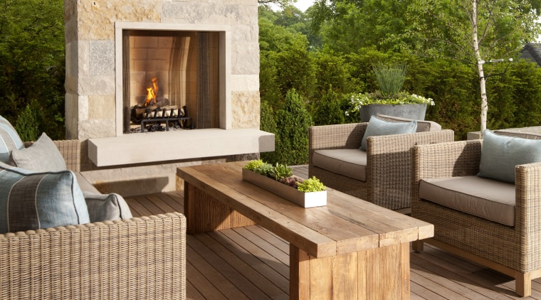 Wisconsin limestone features on the outdoor fireplace chimney deck, floor, flooring, furniture, hardwood, interior design, laminate flooring, living room, outdoor structure, patio, wood, wood flooring, brown, white, orange