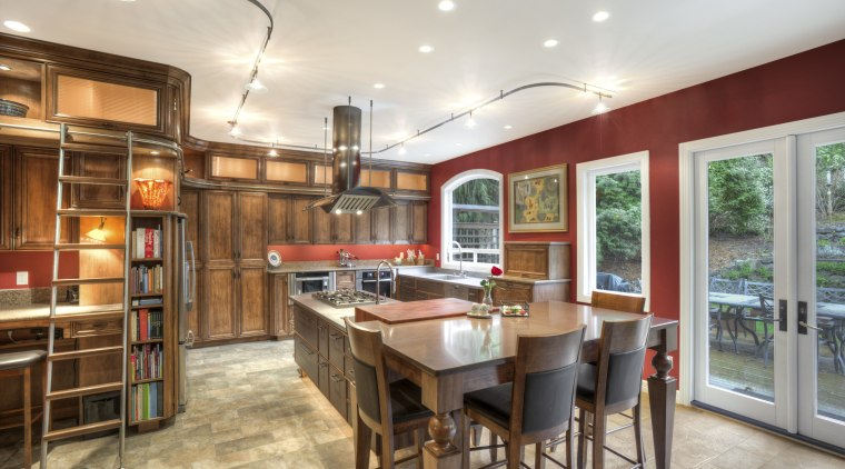 This Richard Landon kitchen has a warm aesthetic ceiling, countertop, interior design, kitchen, real estate, room, gray, brown