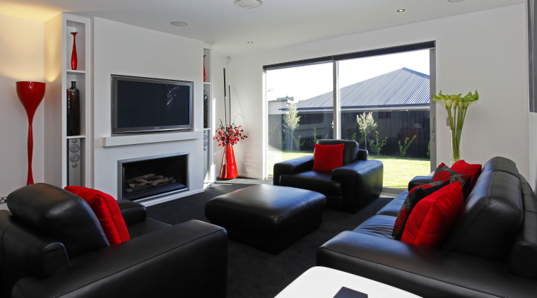 The crisp black and white interior is enlivened interior design, living room, real estate, room, gray, black