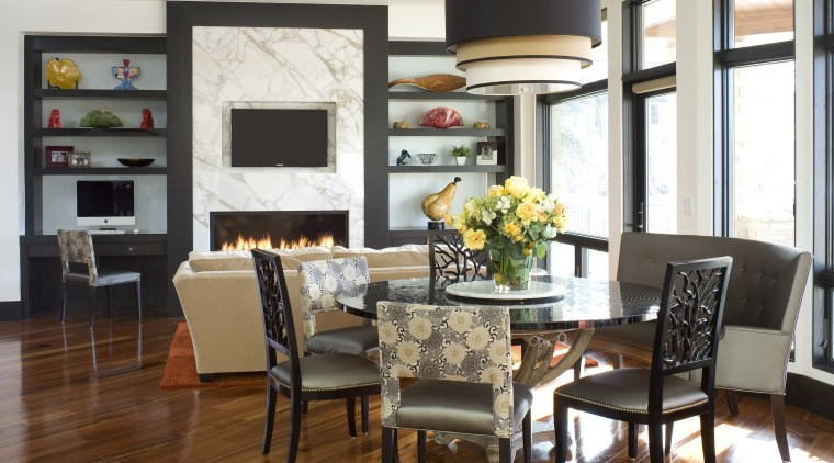 Black frames and polished wood floors provide a dining room, furniture, home, interior design, living room, room, table, white