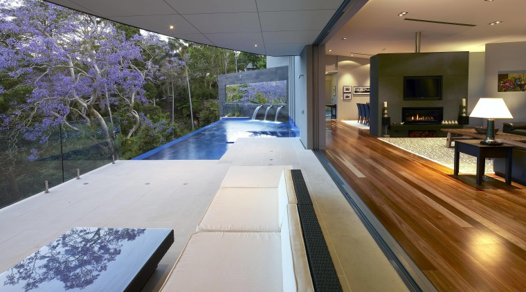 A mirror attached to the bluestone-clad blade wall architecture, daylighting, estate, home, house, interior design, real estate, swimming pool, gray, brown