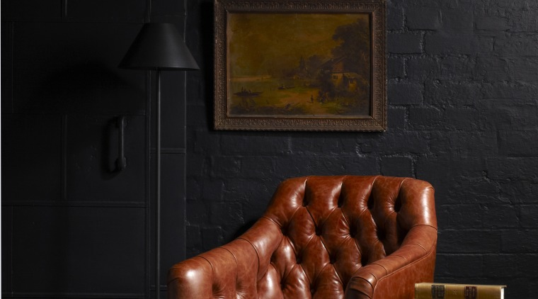 Warwick Fabrics carries a broad selection of high-end couch, darkness, furniture, interior design, lighting, still life, still life photography, wall, black