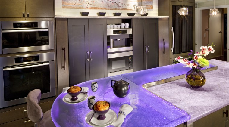 Glass countertops illuminated with violet lighting ensure this countertop, home appliance, interior design, kitchen, room
