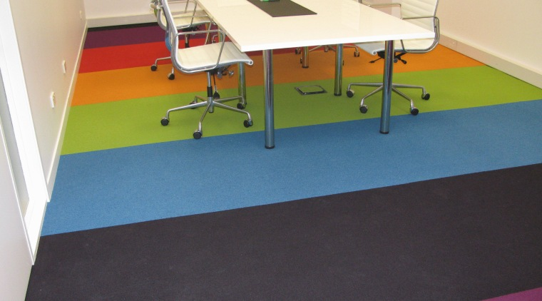 Fashion design and marketing specialist Atlantic Apparel commissioned carpet, floor, flooring, furniture, hardwood, laminate flooring, table, tile, wood, wood flooring, orange, black