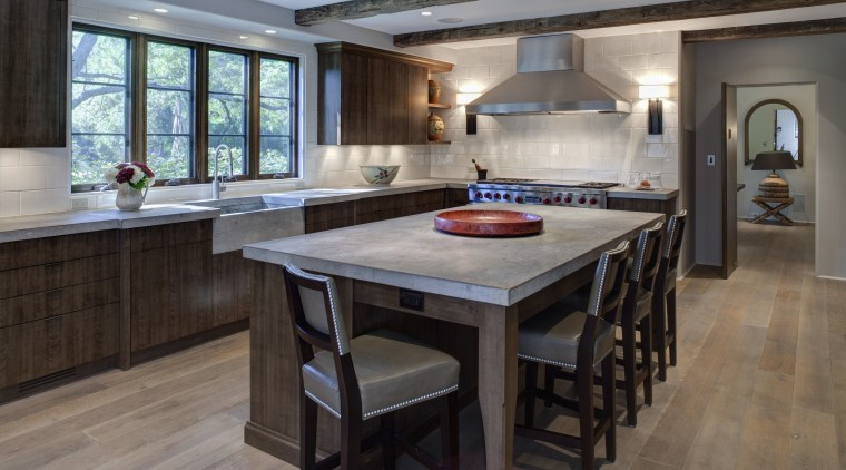In this kitchen remodel by Doug Durbin, the cabinetry, countertop, cuisine classique, floor, flooring, hardwood, interior design, kitchen, laminate flooring, room, wood flooring, gray, black