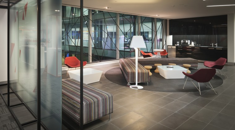 A multifaceted facade behind the reception desk of floor, flooring, furniture, glass, interior design, lobby, table, black, gray