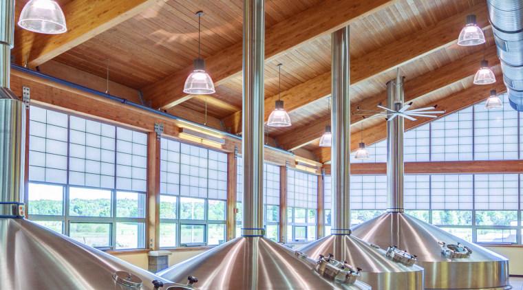 Engineering innovation, energy efficiency and designer aesthetics define ceiling, daylighting, interior design, table, wood, brown