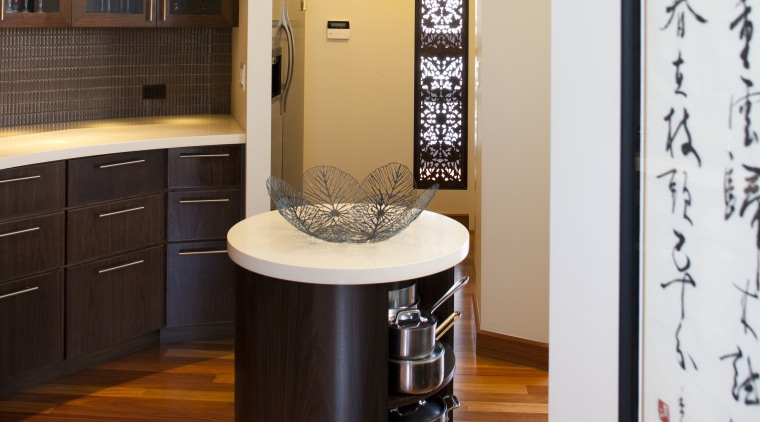 The small central island in this kitchen remodel bathroom, bathroom accessory, cabinetry, countertop, floor, flooring, hardwood, interior design, kitchen, room, wood flooring, white