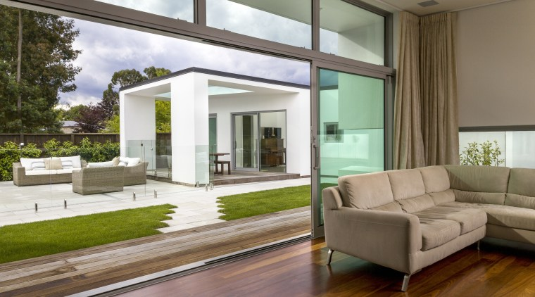 This aluminium sldiding door system by Fairview Wellington architecture, daylighting, door, estate, floor, home, house, interior design, living room, property, real estate, window, brown, white
