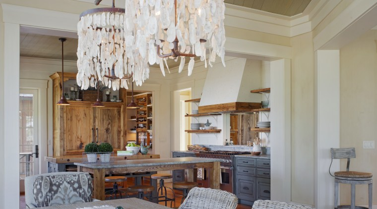 The dining area of this family room includes ceiling, chandelier, dining room, home, interior design, living room, real estate, room, window, gray