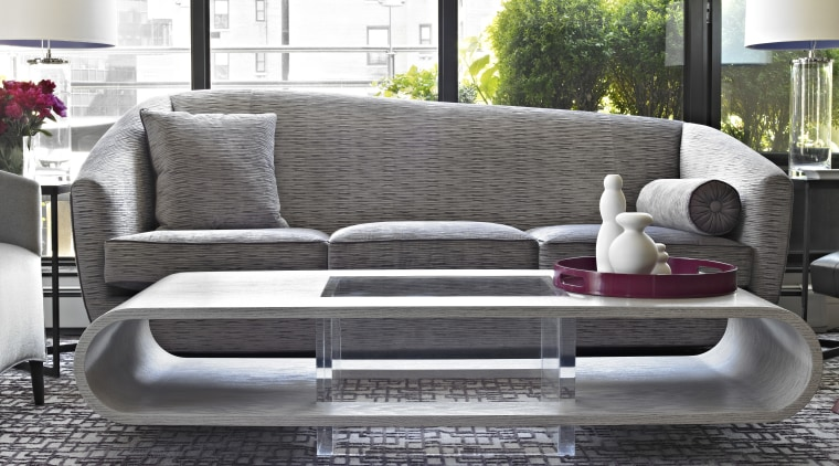 The asymmetrical sofa was custom designed by Coffinier angle, coffee table, couch, floor, flooring, furniture, interior design, living room, loveseat, product design, sofa bed, table, gray, white