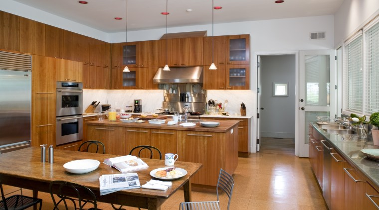 Cherry wood cabinetry wraps around the perimeter of cabinetry, ceiling, countertop, cuisine classique, interior design, kitchen, real estate, room, gray, brown