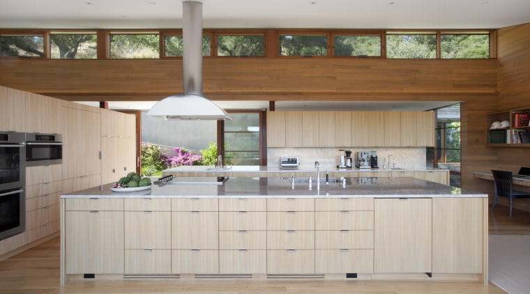 Clerestory windows provide views of the hillside behind cabinetry, countertop, cuisine classique, hardwood, interior design, kitchen, room, gray