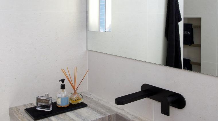 This bathroom was transformed by designer Celia Visser, bathroom, countertop, floor, interior design, product design, room, sink, tap, tile, gray, white
