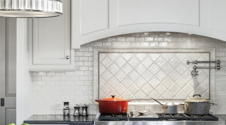A backsplash panel in diagonally set raised pillow cabinetry, countertop, cuisine classique, floor, home, interior design, kitchen, room, window, gray
