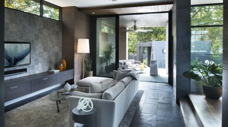 Family room with textured feature wall  part architecture, house, interior design, living room, real estate, black, white